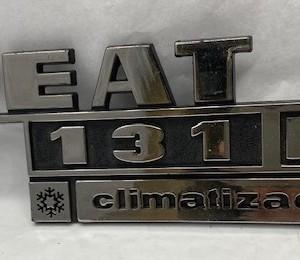 CA131617-ANAGRAMA-TRASERO-SEAT-131-E-CLIMATIZADO